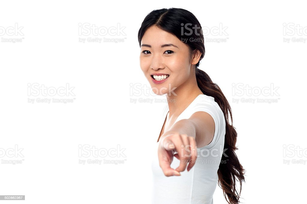 Gorgeous young girl pointing you out stock photo