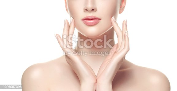 1070715740 istock photo Gorgeous, young woman with clean, fresh skin is holding graceful hand in front ownself. Beauty and cosmetology. 1026057398