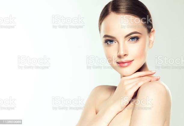 Gorgeous young woman with clean fresh skin is touching own face light picture id1128659989?b=1&k=6&m=1128659989&s=612x612&h=bh7vjkjowiso38j3xxf7p7dkczkdw8qajdrvkg4ceky=