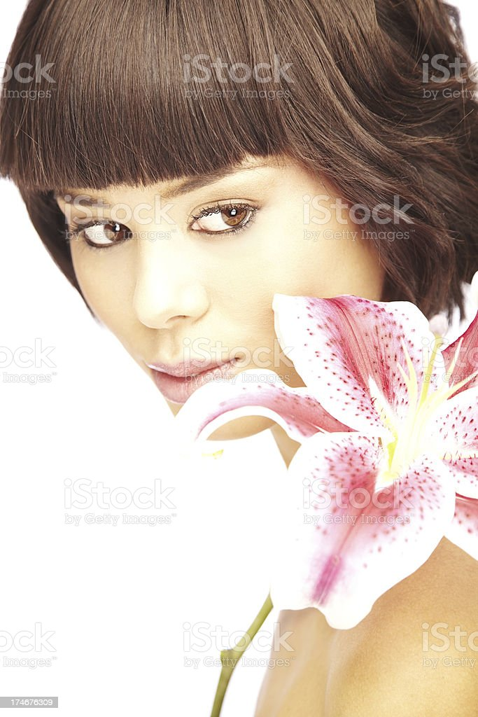 Gorgeous Young Woman with Stargazer Lily on Her Shoulder royalty-free stock photo