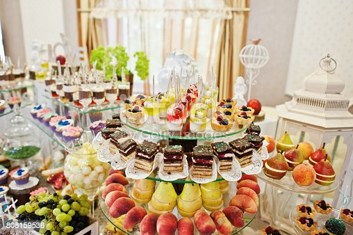 istock Gorgeous-looking wedding table with various beverages, delicious dishes, fruits and decorations. 808159536