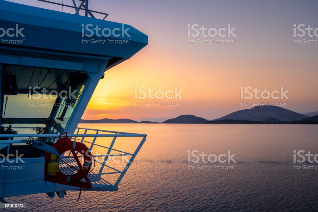 Gorgeus sunset from the deck of a ship, Corfu, Greece. stock photo