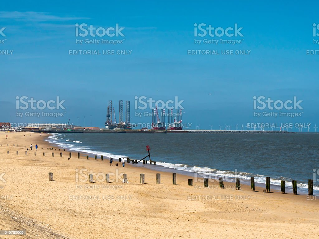 Gorleston beach with outer harbour and wind farm stock photo
