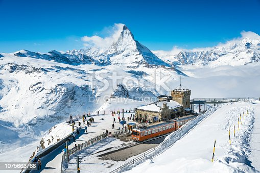 People at Gornergrat railway station (3.089 m) with Matterhorn peak above Zermatt town in Mattertal, Valais canton, Switzerland, in winter. Taken by Sony a7R II, 42 Mpix.