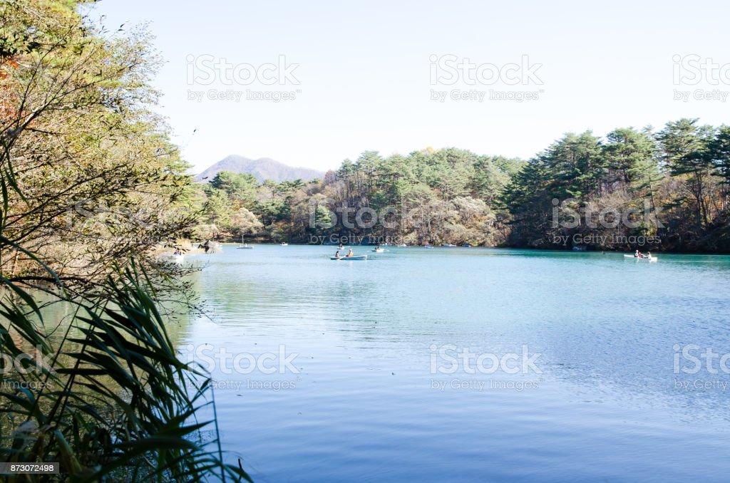 Goshiki-numa in Autumn, Urabandai, Fukushima, Japan - Bishamon-numa with Rowboat stock photo