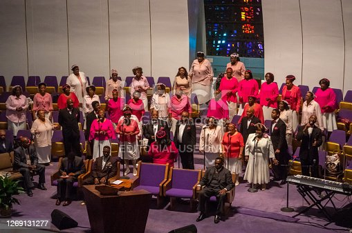 New York City, USA - October 8, 2017: Group of people singing gospel music in the Church The Greater Refuge Temple in Harlem, New York City