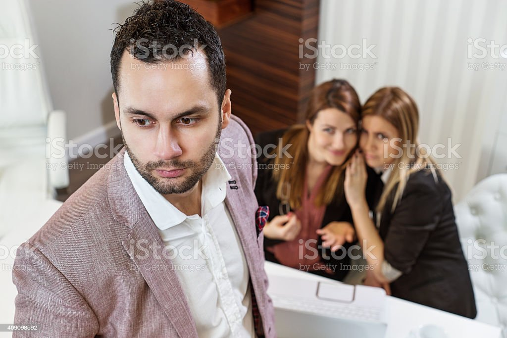 Gossip girls, businessman. stock photo