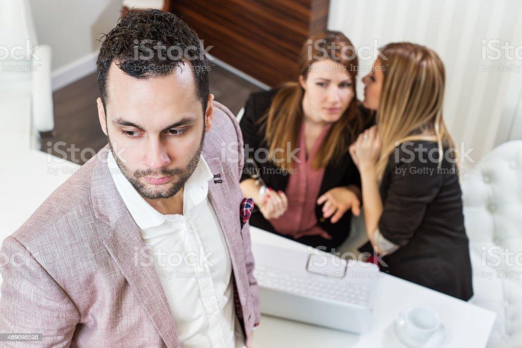 Gossip girls, businessman. stock photo