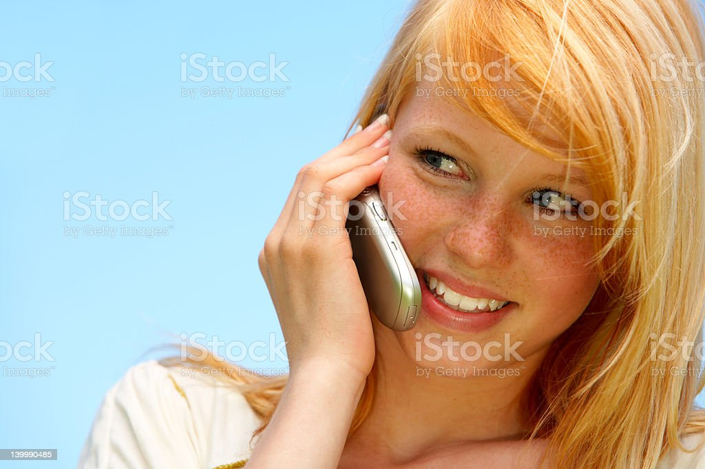 Gossip - Young woman talking on cellphone royalty-free stock photo