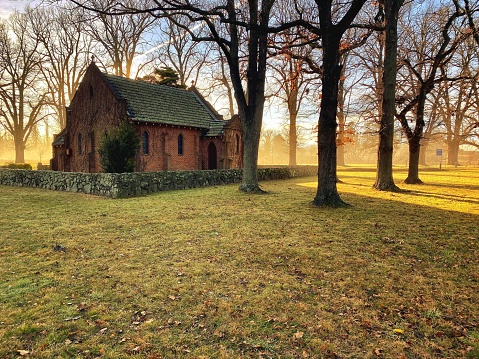 Horizontal landscape photo of the All Saints Anglican Church, also known as the Gostwyck Chapel near Armidale, on a sunny morning in Winter