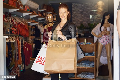 Cropped shot of an attractive young woman on a shopping spree
