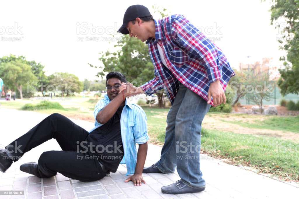 I got you buddy, get up. stock photo