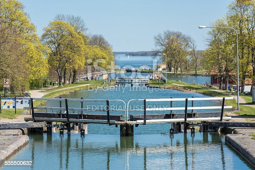 Berg, Sweden - May 6, 2016: People visit Gota Canal locks near Berg outside Linkoping. The Canal completed in 1832 contributes to a 390 km long waterway with 58 locks connecting the Swedish west coast with the east coast.