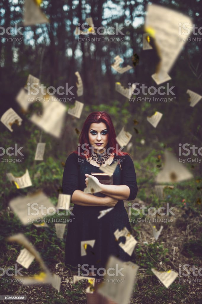 Goth girl embracing book stock photo