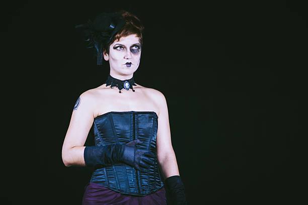 goth girl in black background - dracula schminken stock-fotos und bilder
