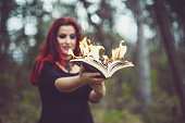 Goth girl with pages ablaze