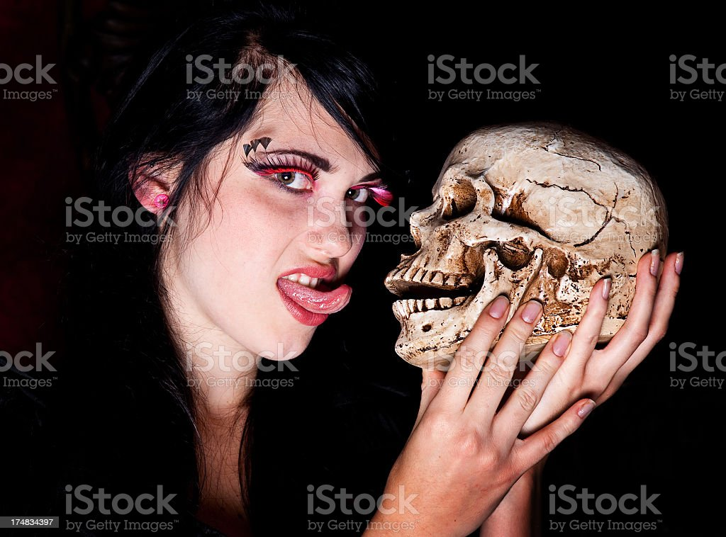 Goth Woman with a Skull royalty-free stock photo