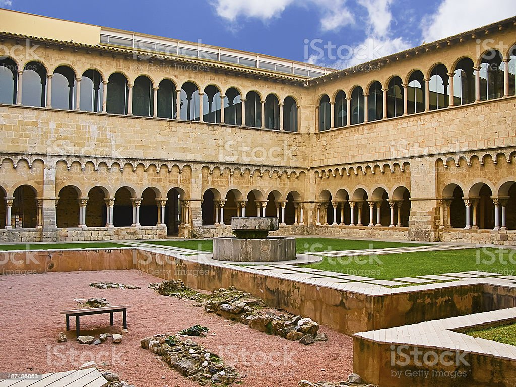 Gothic abbey monastery and cloister from garden perspective, in royalty-free stock photo