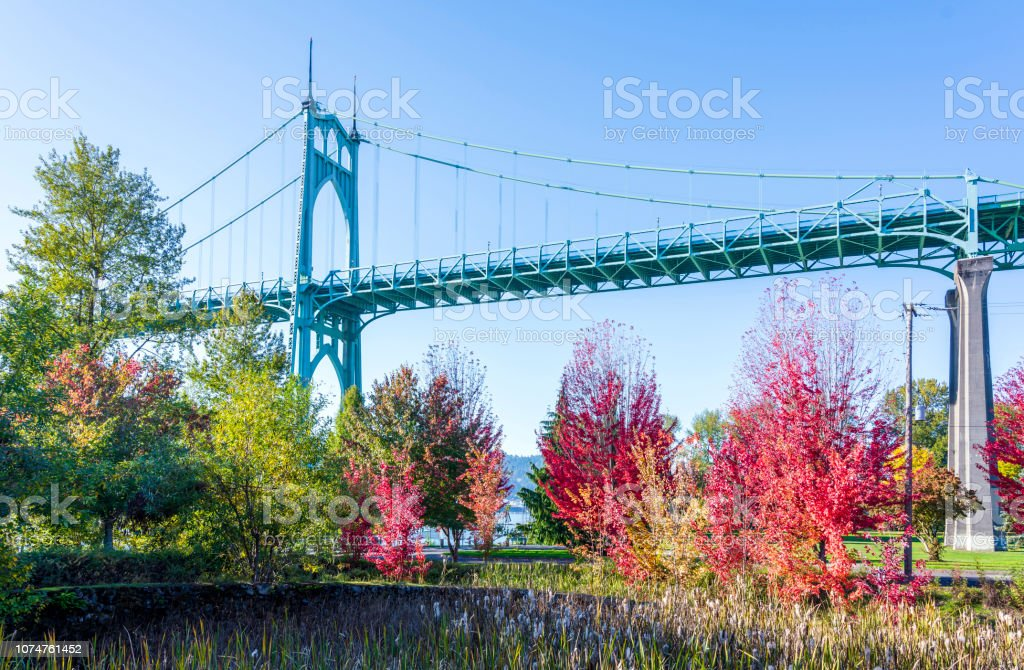 Gothic arch St Johjns bridge in Portland in the colors of the autumn park stock photo