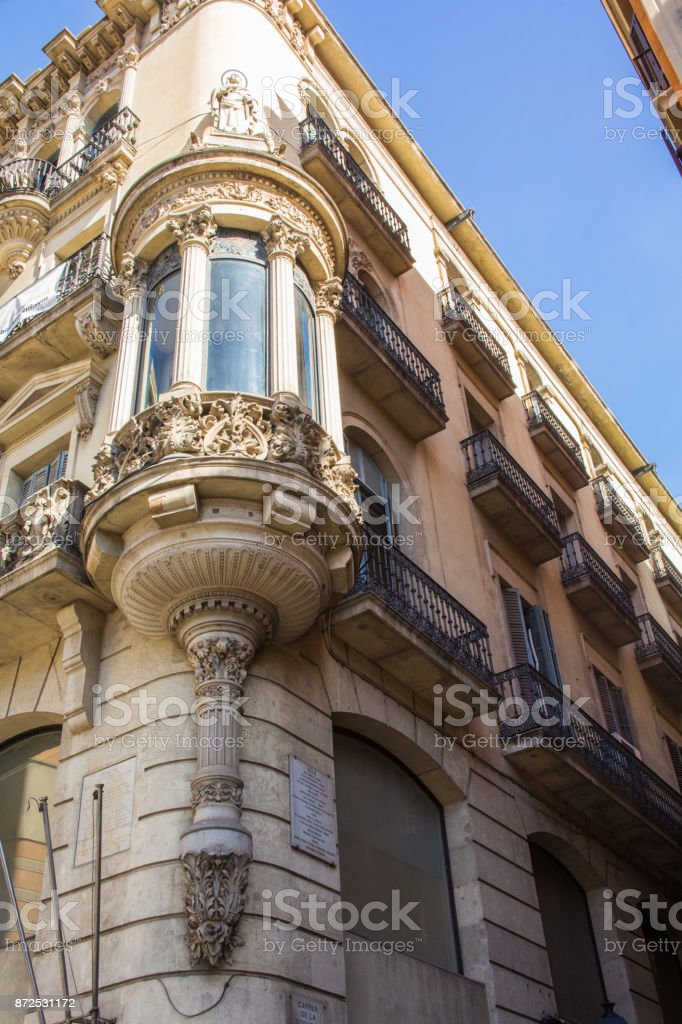 The corner of a building in Barcelona Spain with ornate masonry work...