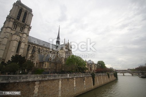 Gothic cathedral in West Portals Facade of Notre Dame, France, historic monuments detail ancient statue art outside of cathoric church, travel destination backgrounds