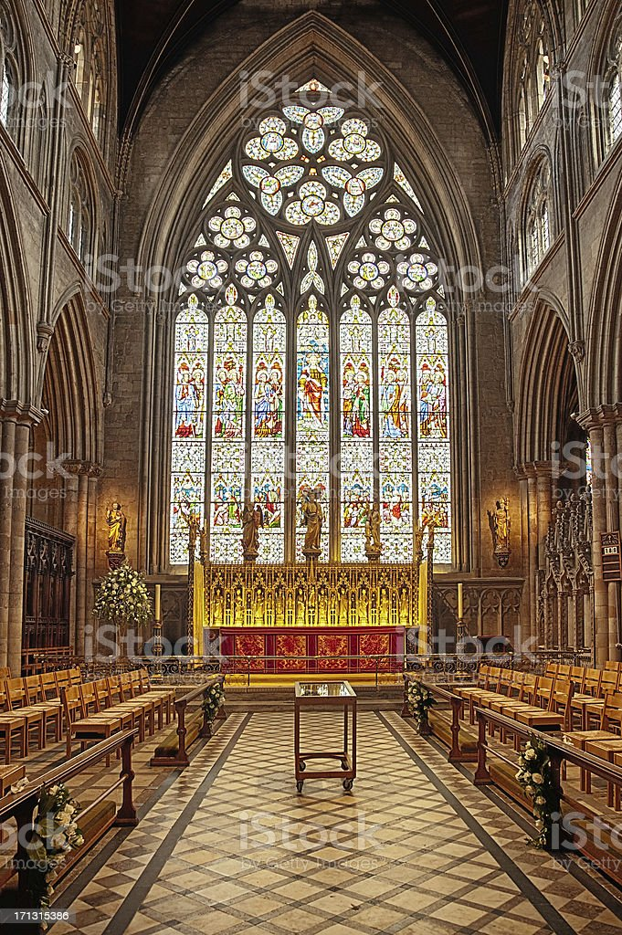 Gothic choir with stained glass window royalty-free stock photo