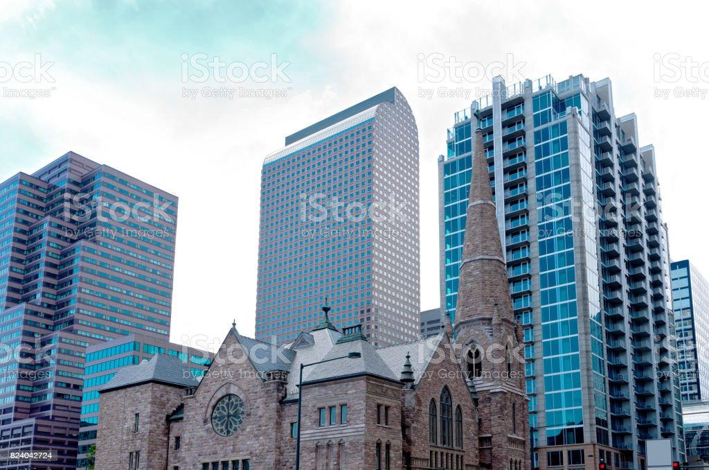 Gothic Church Against Skyscrapers stock photo