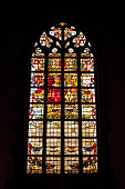Braine-le-Chateau, Belgium - July 31, 2009: Stained Glass window in the Church of Braine-le-Chateau, Wallonia, Belgium, depicting a Coat of Arms with Motto Sicut Lilium (like the Lily).