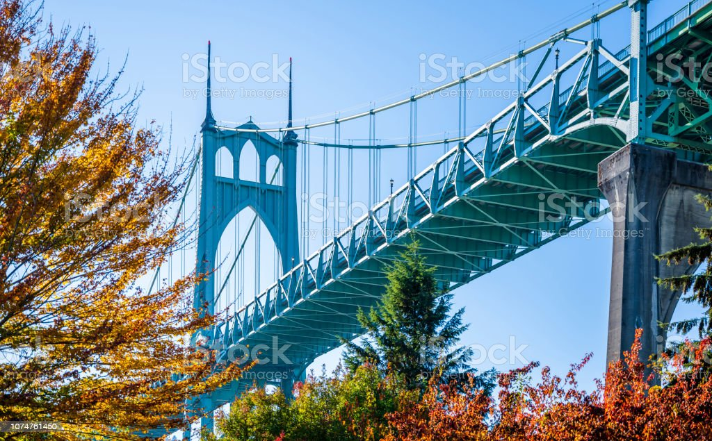 Gothic drawstring St Johns bridge in Portland surrounded by autumn trees stock photo