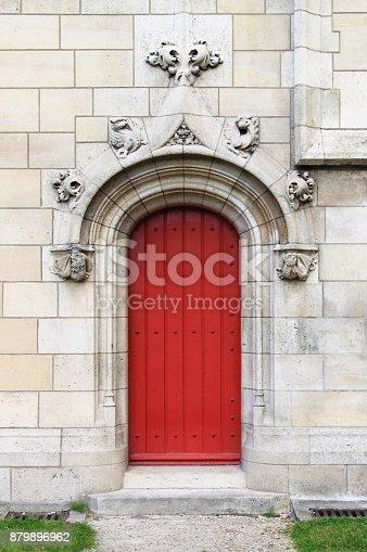 914134406 istock photo Gothic front door in the downtown of Paris 879896962