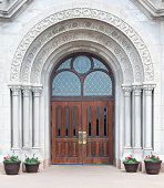 'An ornate Gothic arch with rich, wooden doors. Canon 5D camera, 50mm prime lens.'
