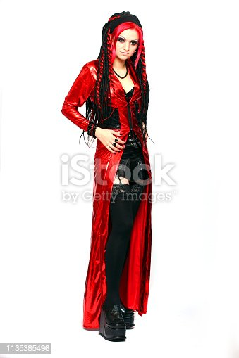 Gothic girl in extravagant latex suit. Fashion and lifestyle theme.