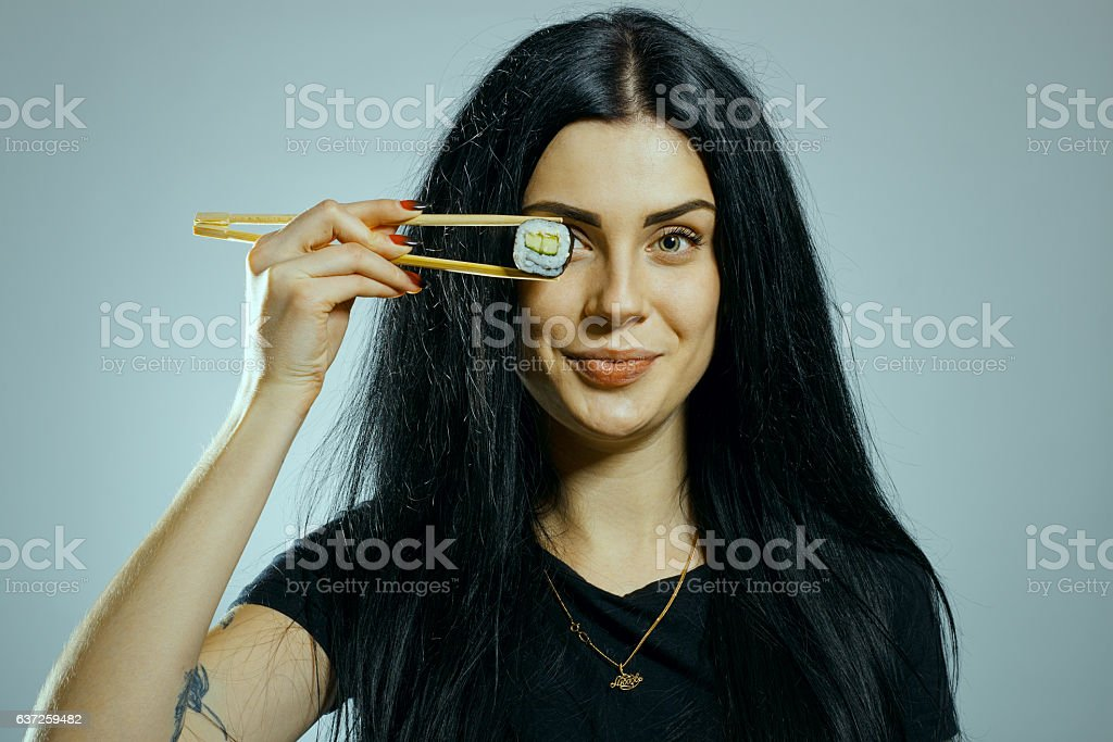 Gothic girl with chopsticks stock photo