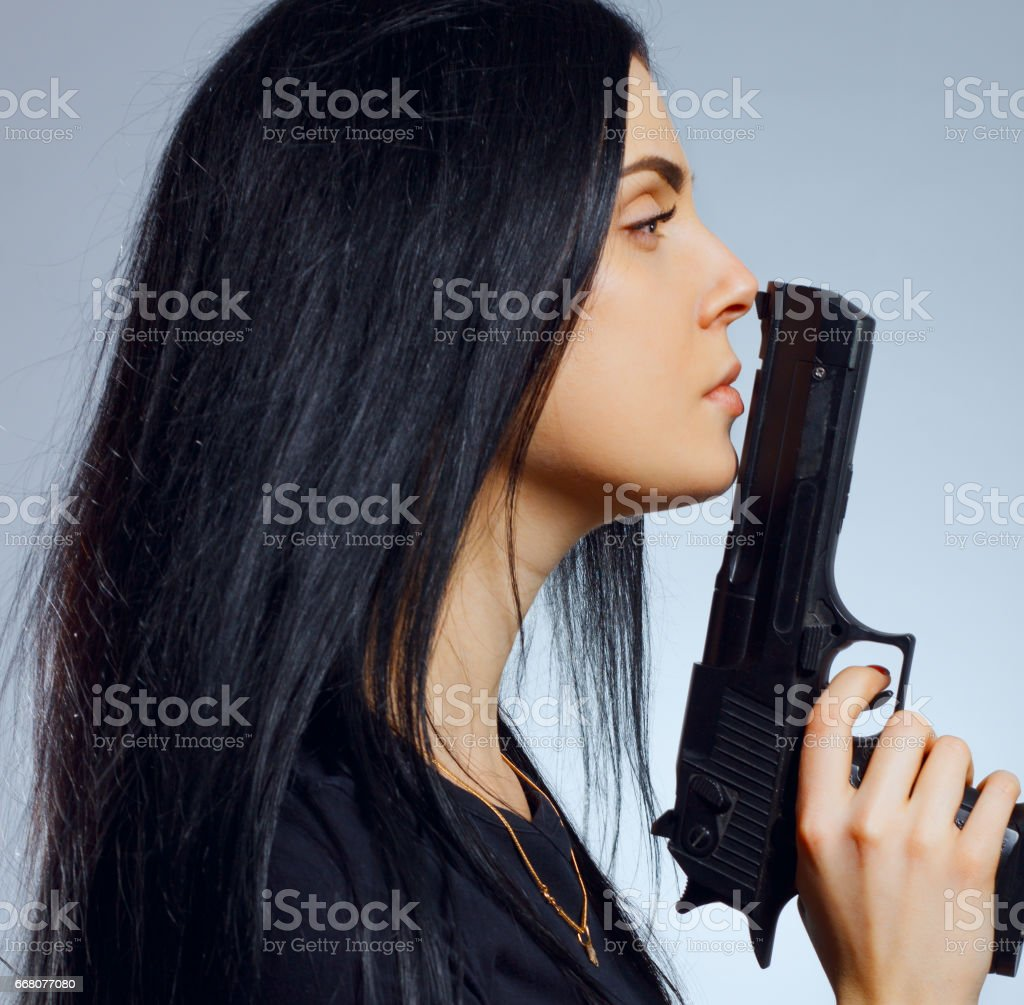 Gothic girl with gun stock photo