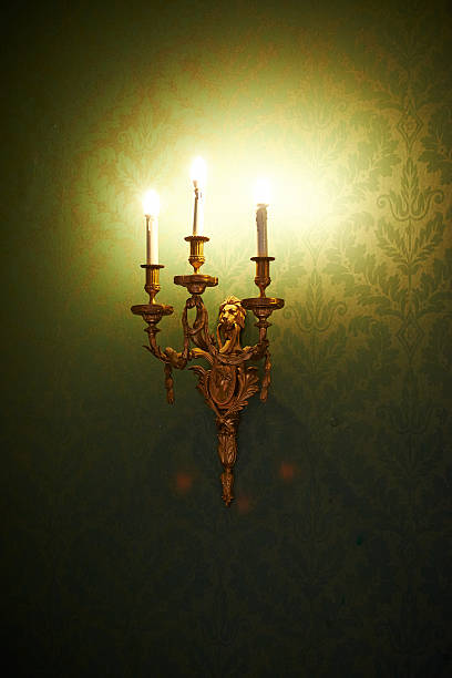 gothic light on green wallpaper - murder mystery stock photos and pictures