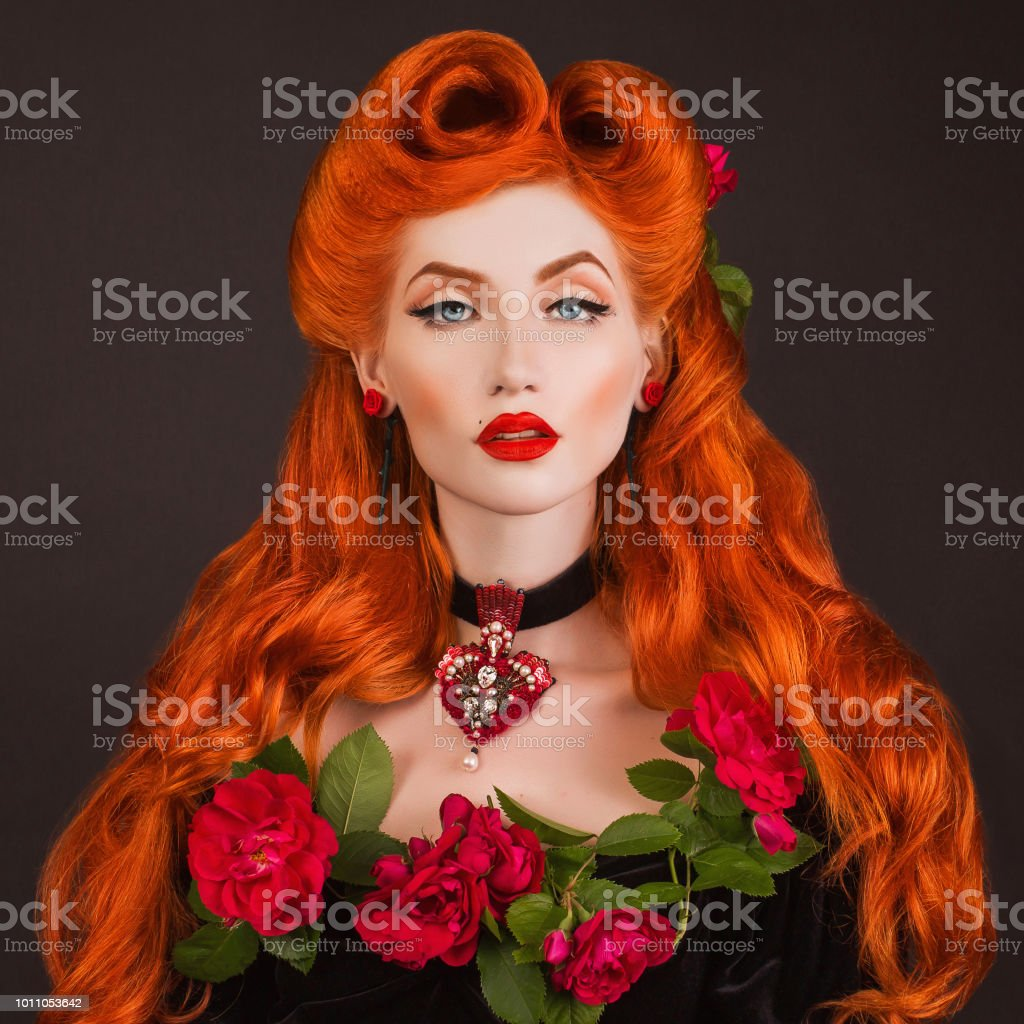 Gothic Queen With Red Lips With Stylish Hairstyle In Studio Beauty