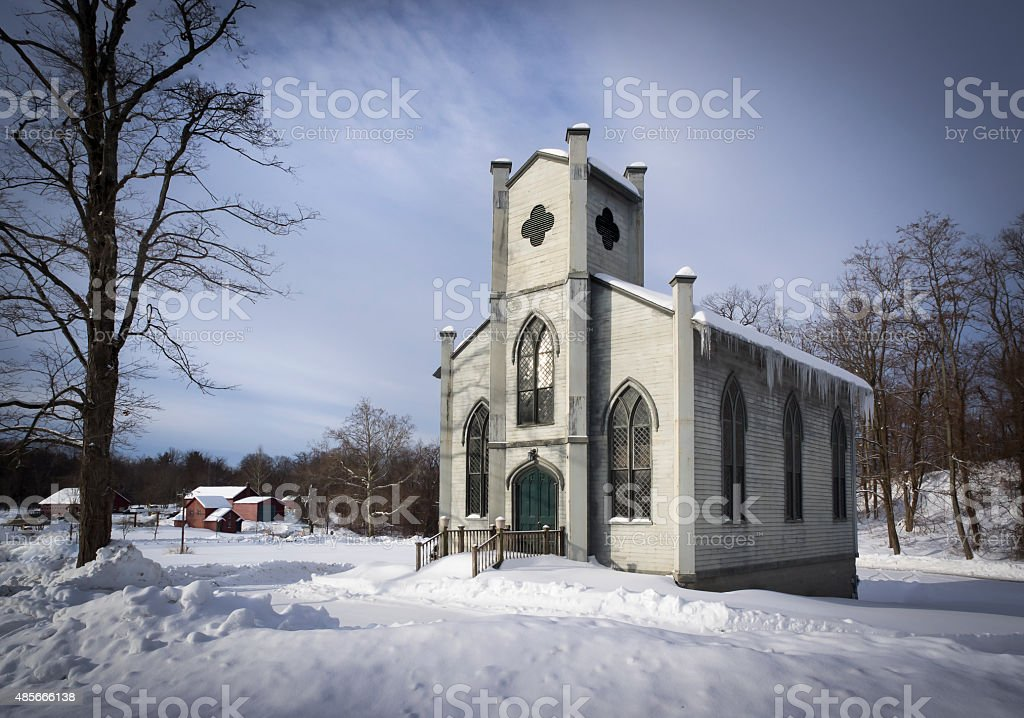 Gothic Revival Church in Winter Snow stock photo