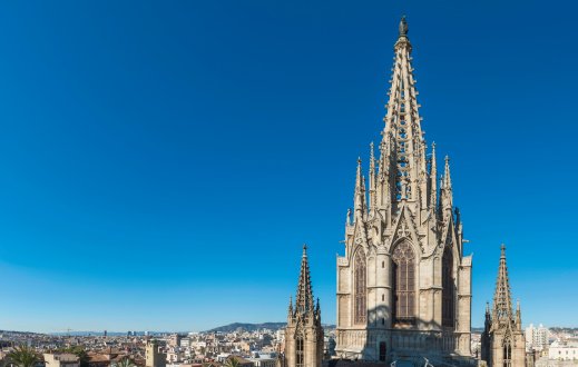 Gothic spire soaring into blue skies Barcelona Cathedral Spain
