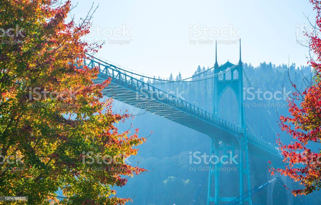Gothic St Johns bridge in portland surrounded by autumn trees stock photo
