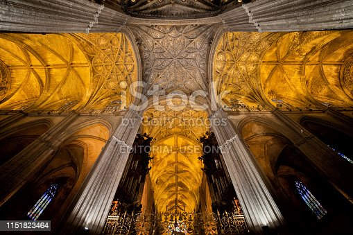 Seville, Spain - April 16, 2012: Gothic ribbed vaults, interior of the Seville Cathedral, the largest Gothic church in the world, UNESCO World Heritage Site.
