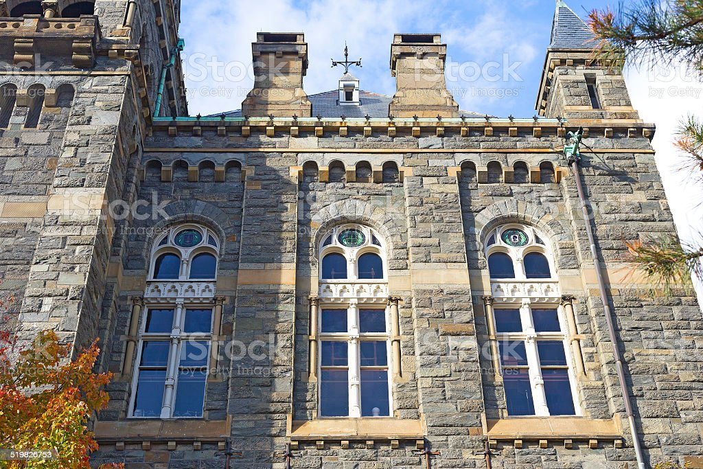 Gothic windows of historic building at Georgetown University. stock photo