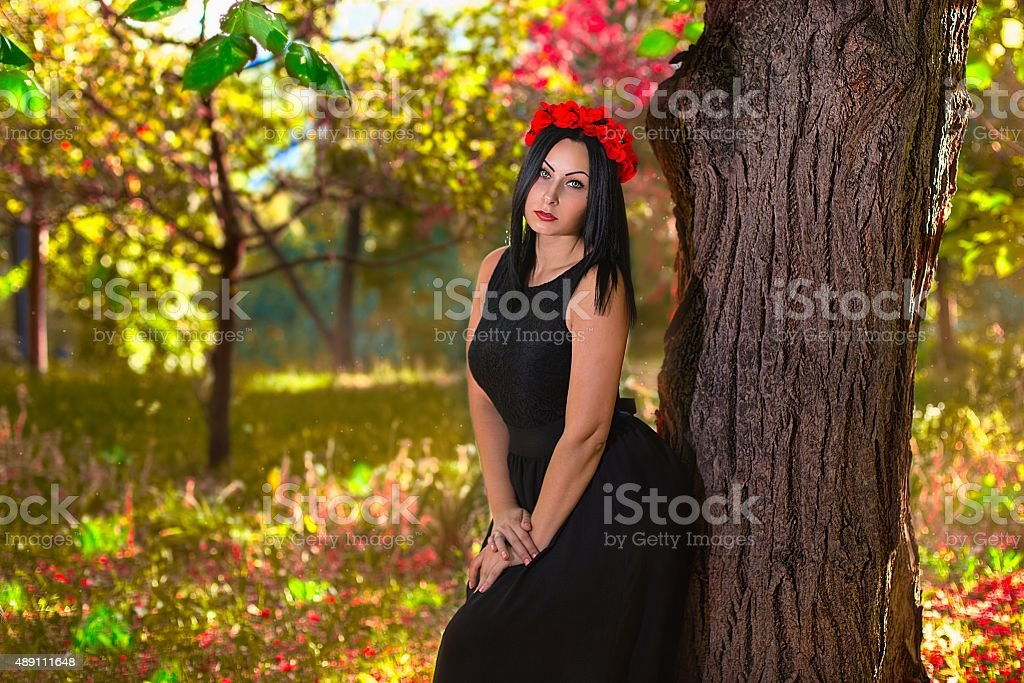 Gothic woman at the colorfull nature background stock photo