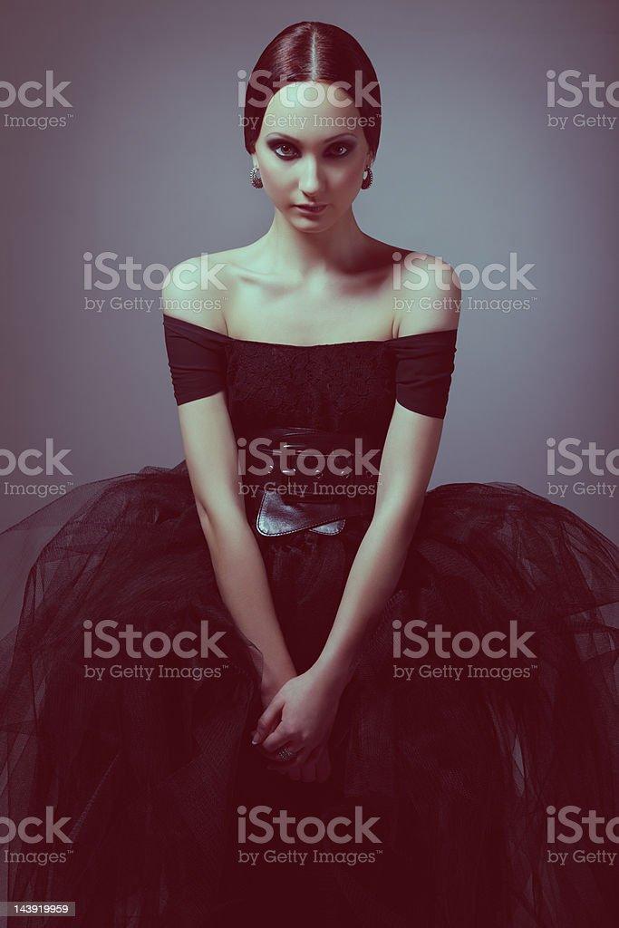 Gothic woman in black dress stock photo