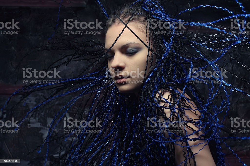 gothic woman with blue  dreadlocks. stock photo