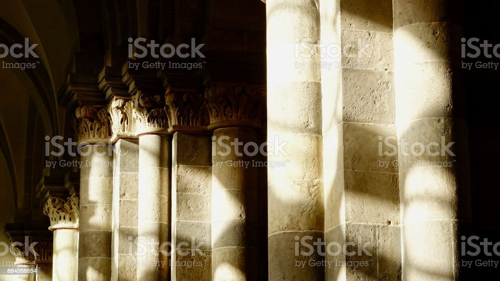 Gotik pillars in shadows and sunlight stock photo