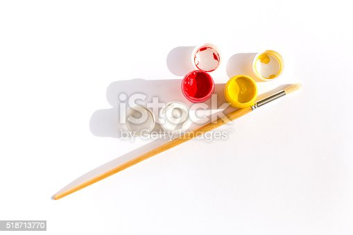 istock Gouache colors and paintbrush on white background 518713770