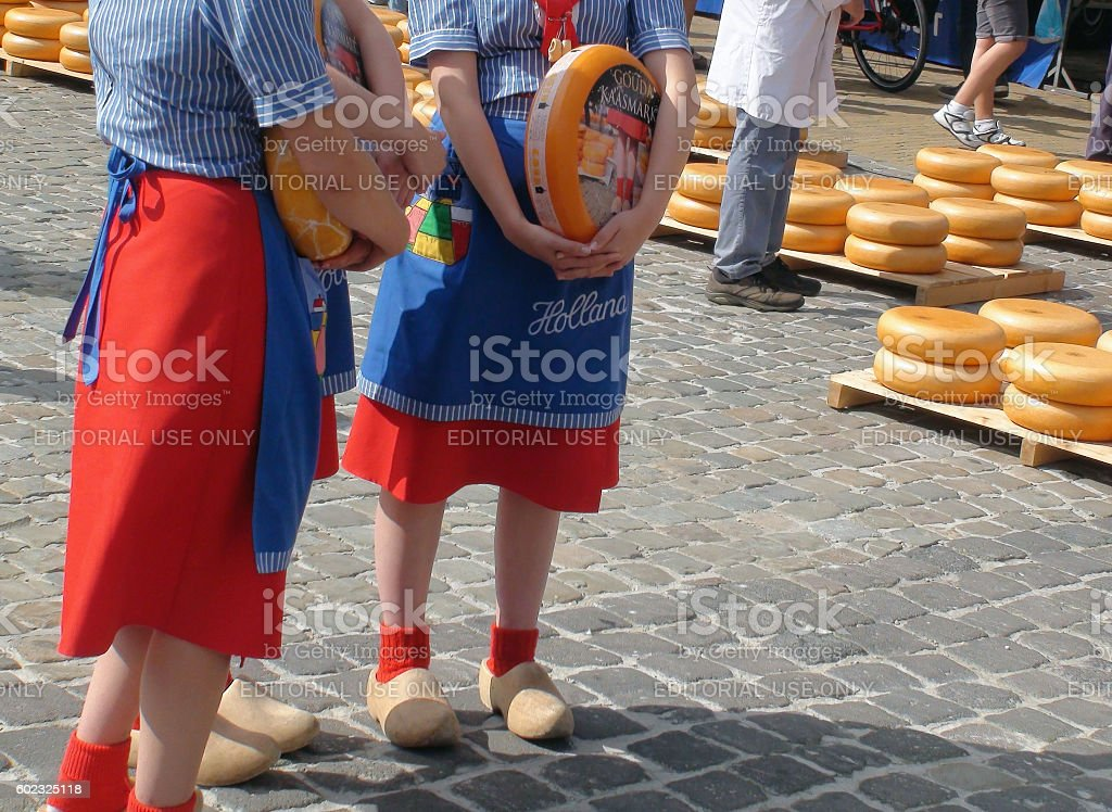 Gouda Cheese Market Officials Carrying Cheese In South Holland.Netherlands stock photo