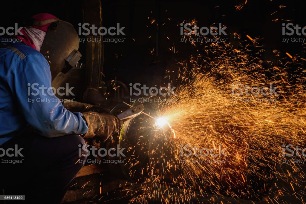 Gouging welding steel structure and bright sparks in steel construction industry. stock photo