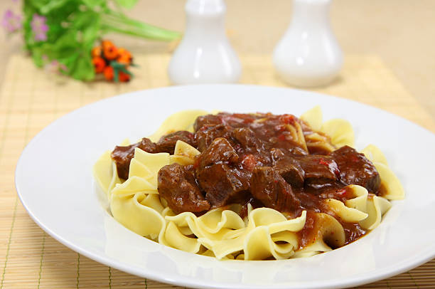 Goulash Goulash with Ribbon Pasta goulash stock pictures, royalty-free photos & images
