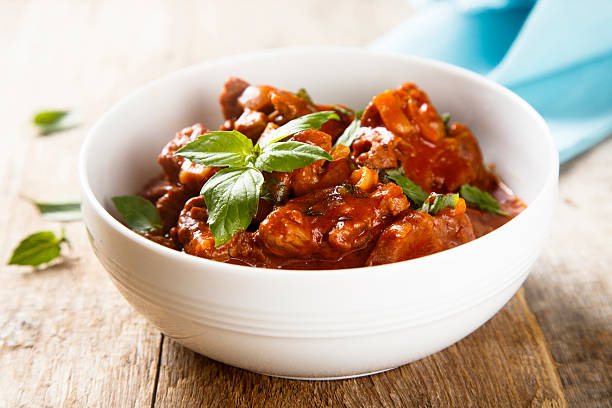 Goulash Goulash with fresh basil goulash stock pictures, royalty-free photos & images
